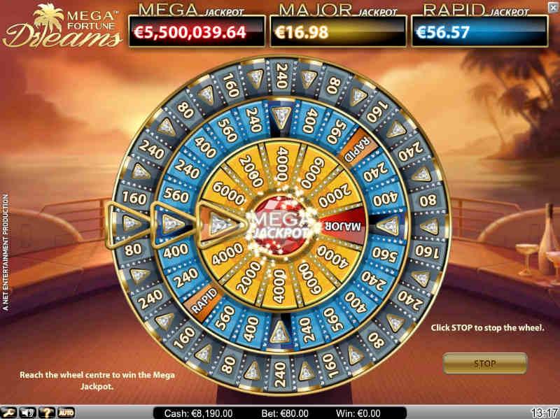 Skärmdump från Mega Fortune Dreams. Här ser vi jackpotthjulet. Hjulet är en kombination av tre stycken hjul. man börjar på det yttersta och vinner förhoppningsvis chansen att gå vidare till det mittersta. Från andra hjulet kan man vinna den minsta jackpotten. För den största måste man gå genom alla hjul.