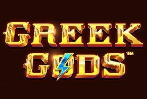 Logotyp tillhörande Greek Gods. Vi ser Greek Gods stå skrivet i guld med en blå blixt över o:et. Bakgrunden är svart/mörkbrun.