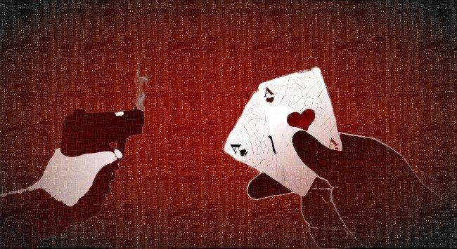 pistol och spelkort. Illustrerar fusk i casinospel